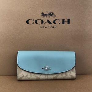Coach long leather wallet signature print and blue
